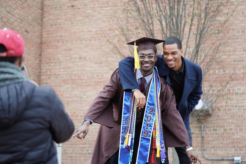 A graduate poses in his regalia.