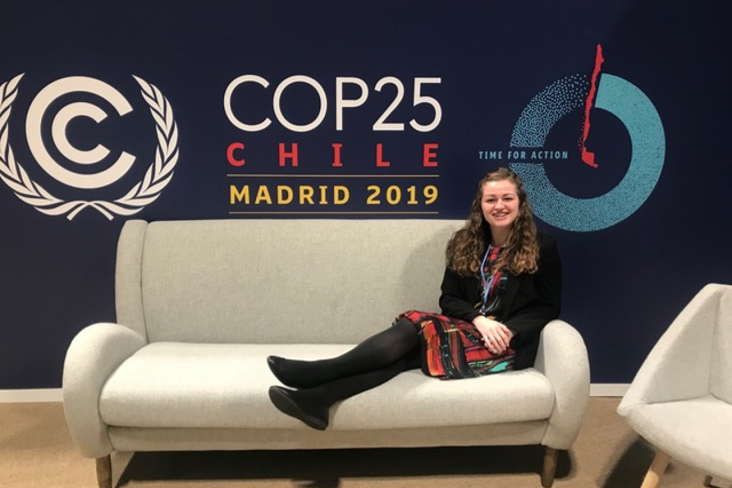 Student Annalisa Wilder sits on a couch at a United Nations conference.