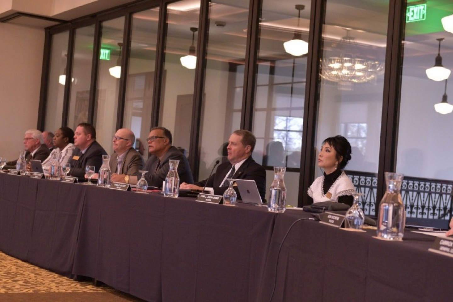A photo of WMU trustees sitting at a table.