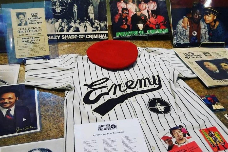 A photo of various pieces of hip-hop memorabilia, including a shirt worn by rap group Public Enemy.