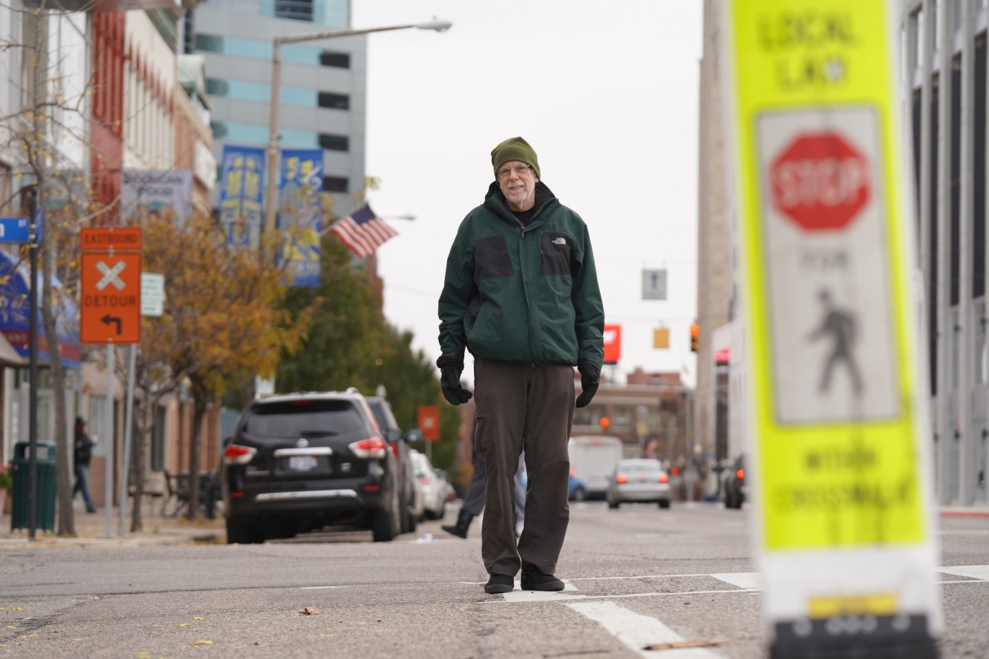 Dr. Ron Van Houten stands in a crosswalk.
