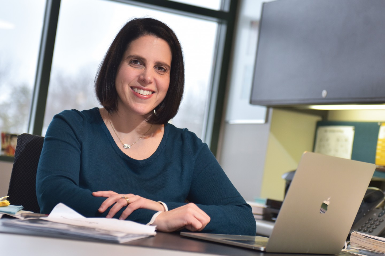 Dr. Laurel Ofstein sitting at desk