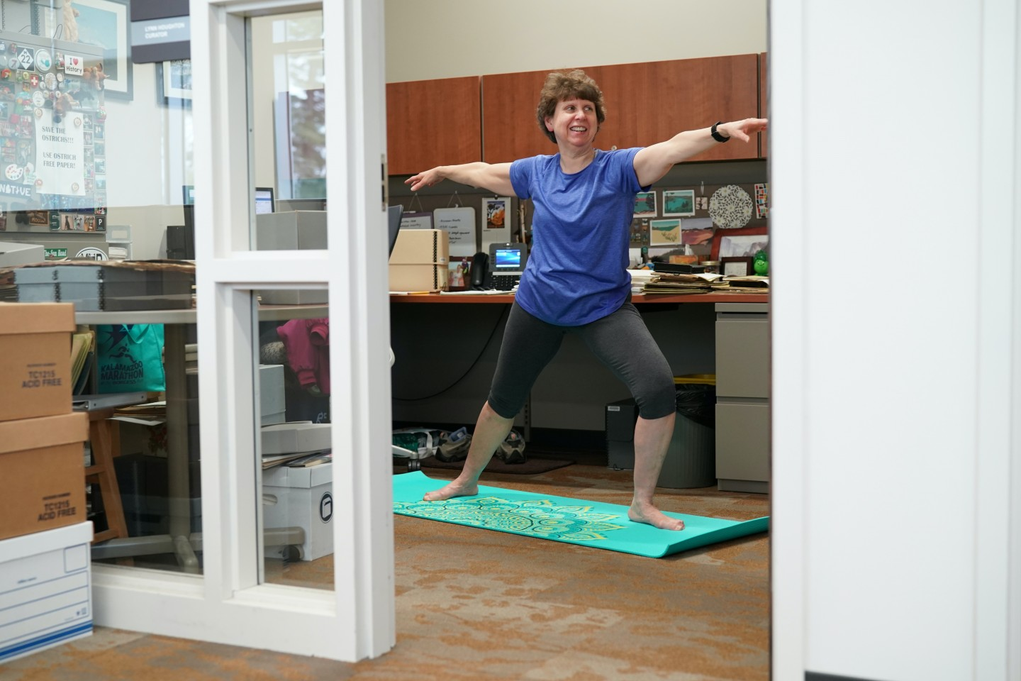 Lynn Houghton, Regional History Collections Curator with WMU University Libraries, does yoga in her office.