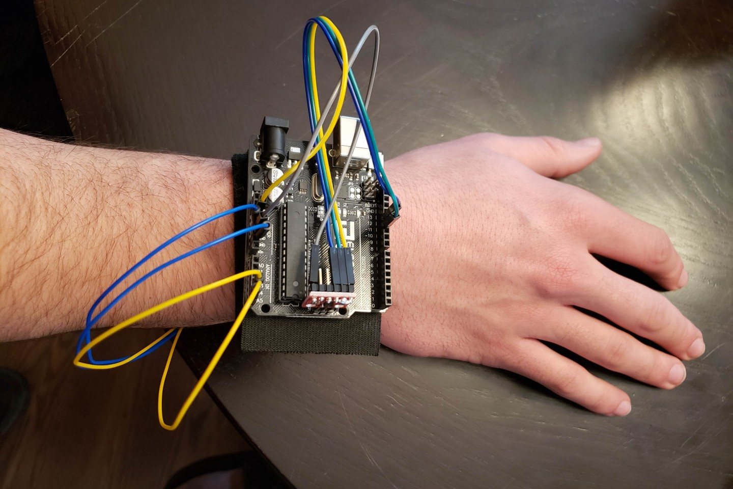 """Someone wearing a """"biomedical wearable for narcolepsy"""" on their wrist."""