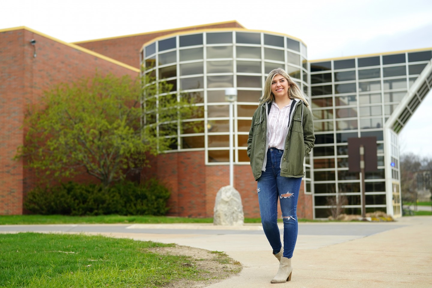 Kassidy Davis walks in front of the Student Recreation Center.