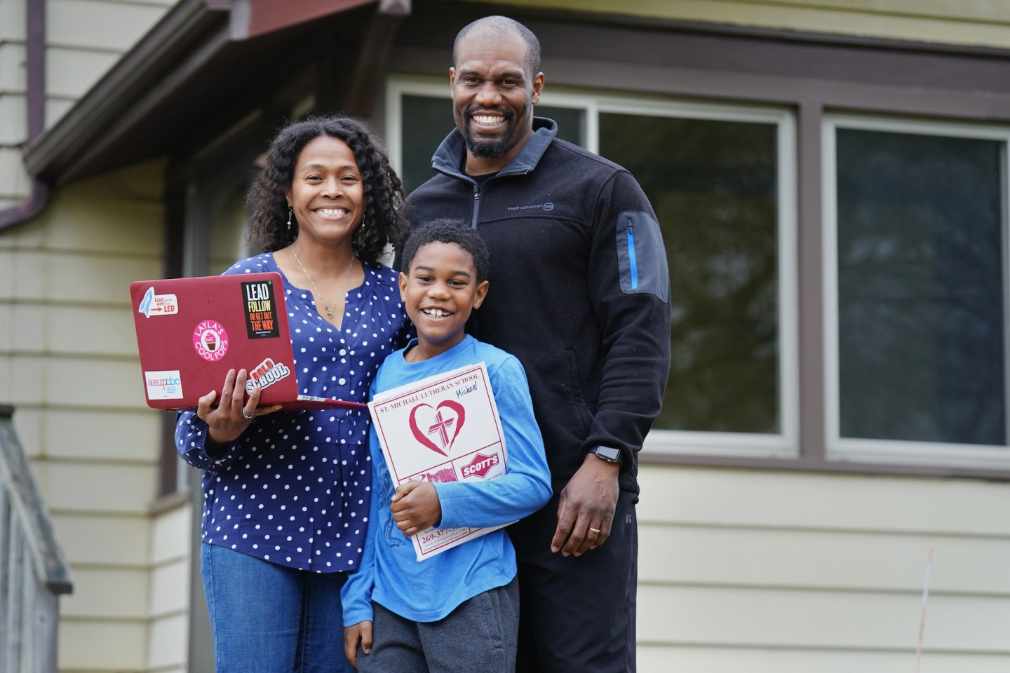 Western Michigan University professor Dr. Luchara Wallace with husband Greg and son Michael.
