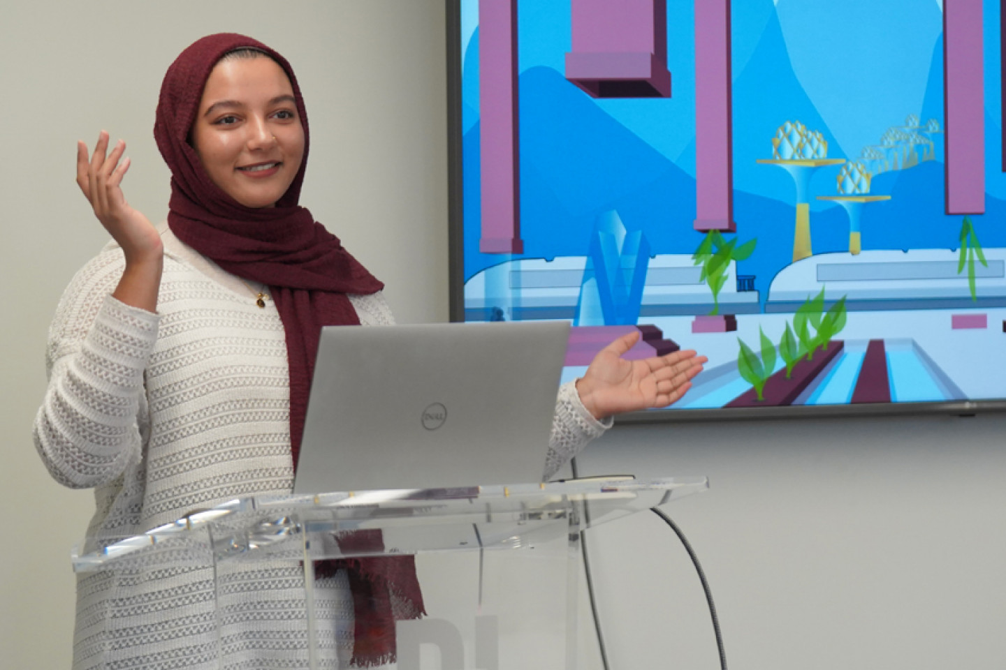 Aisha Thaj gives a presentation to her class.