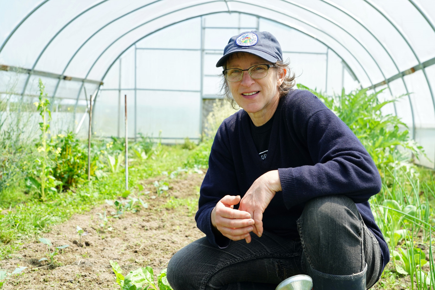 Lori Evesque in her greenhouse at Natural Cycles Farm.