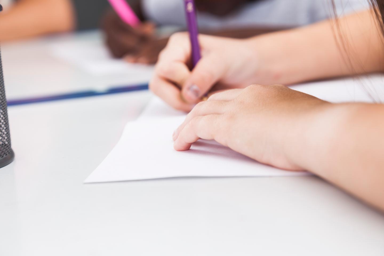 kids writing on paper
