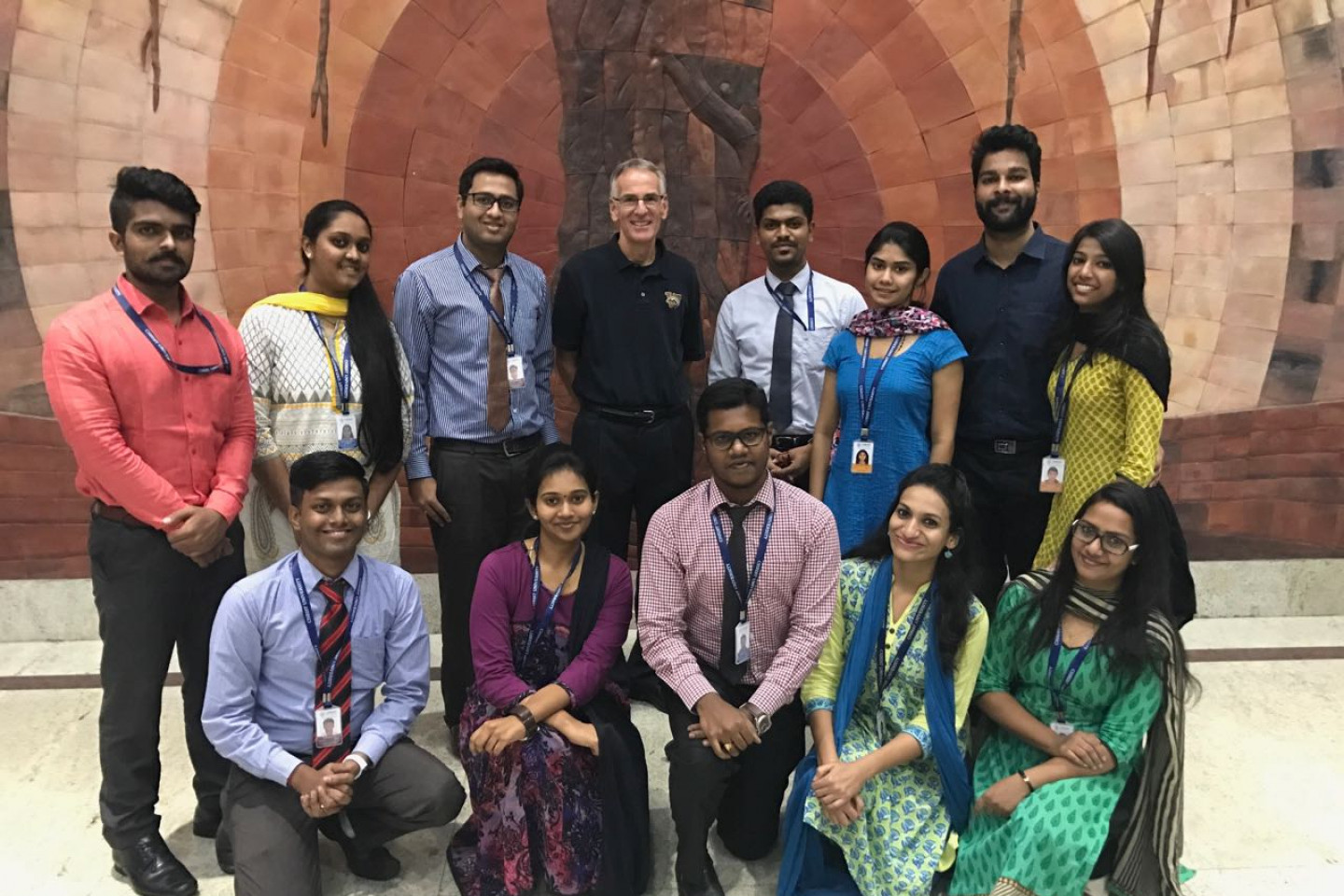Dr. Tim Palmer stands with students on a study abroad trip in India.
