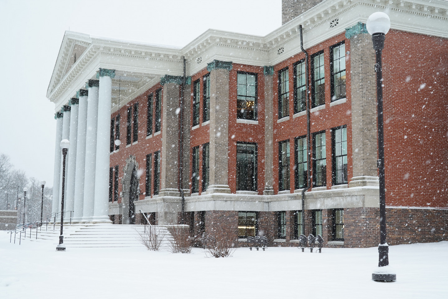 Photo of outside of Heritage Hall during a snowfall.