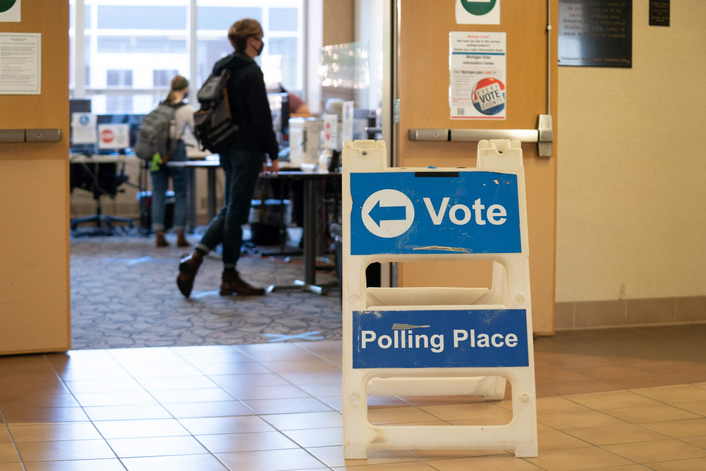 A polling place sign sits outside of a room in the Bernhard Center.
