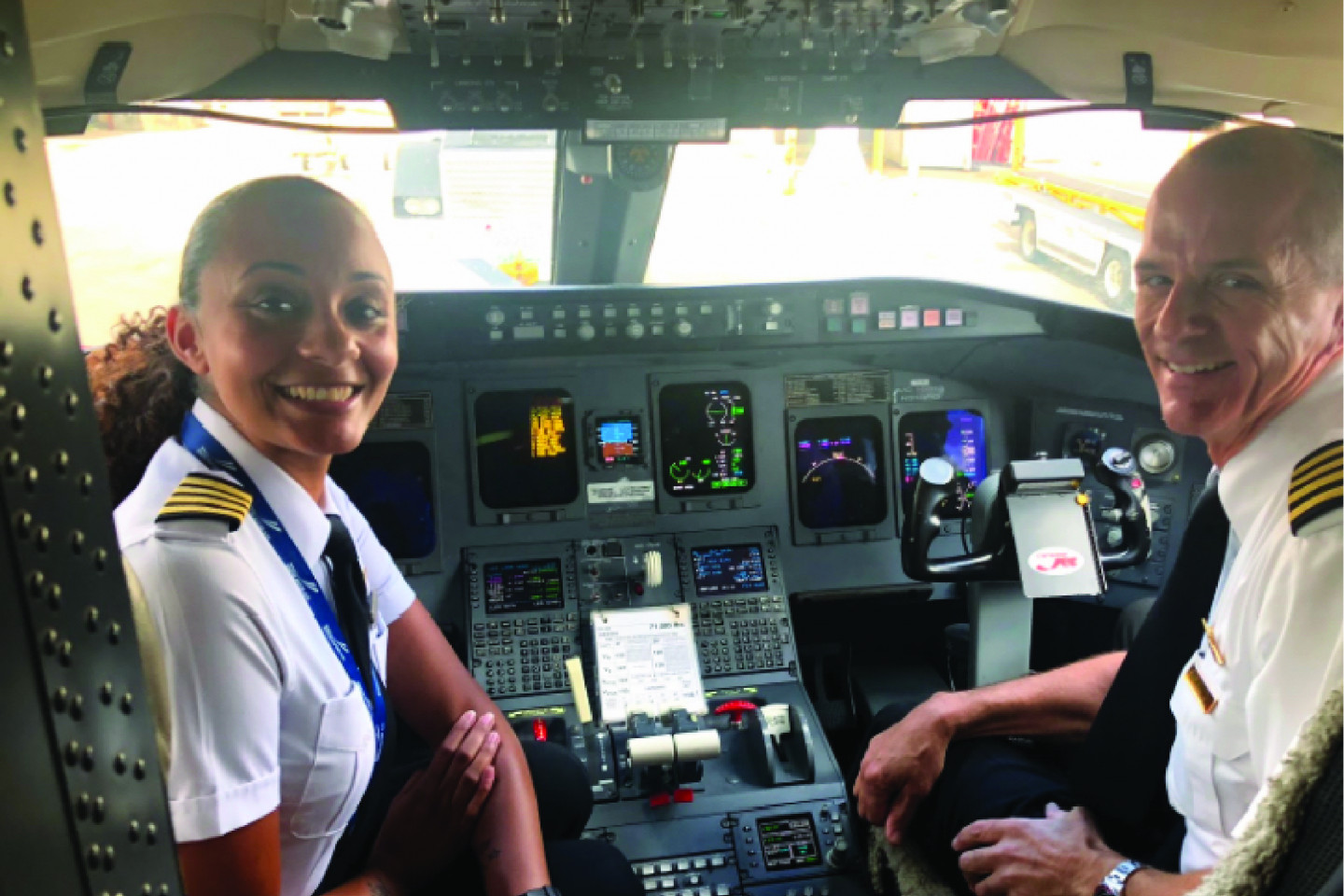Pilot Alexis Brown sits in the cockpit of a plane.