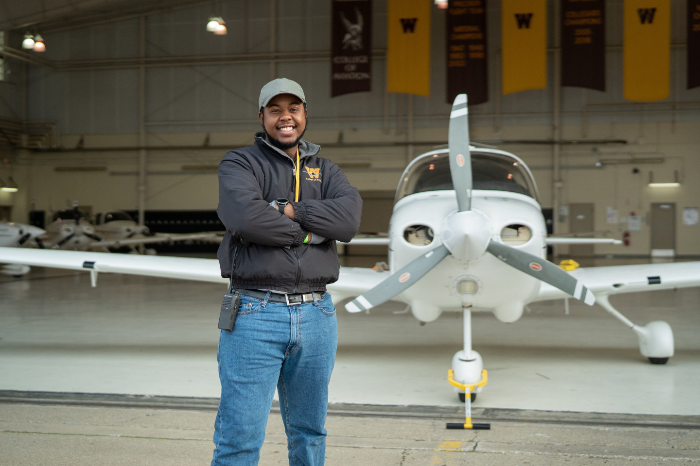 Dezmond Stover stands in front of a plane.