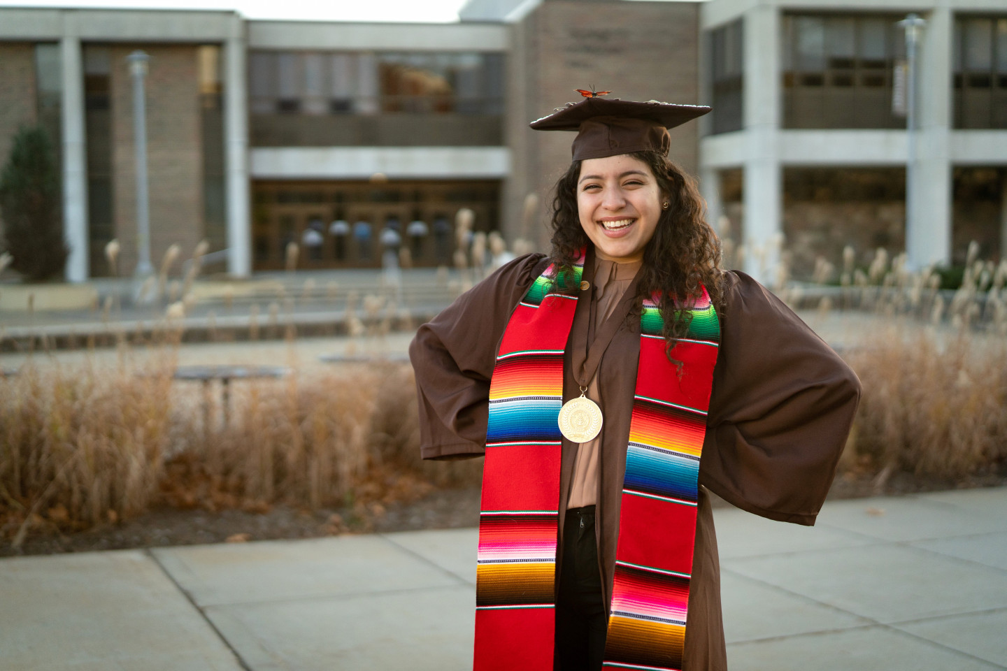 A photo of Valeria Marin in her graduation cap and gown.