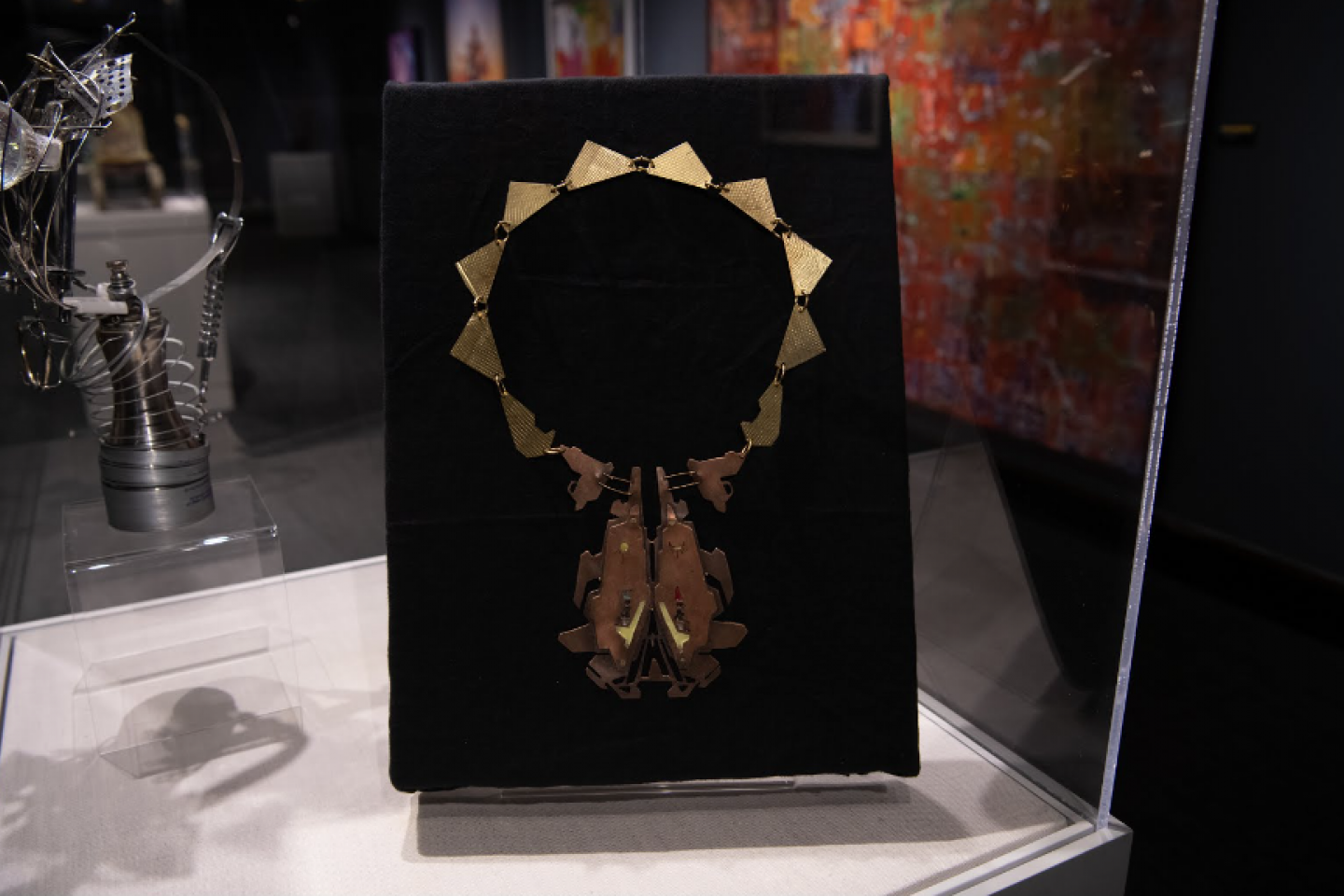 A necklace is displayed in a museum exhibit.