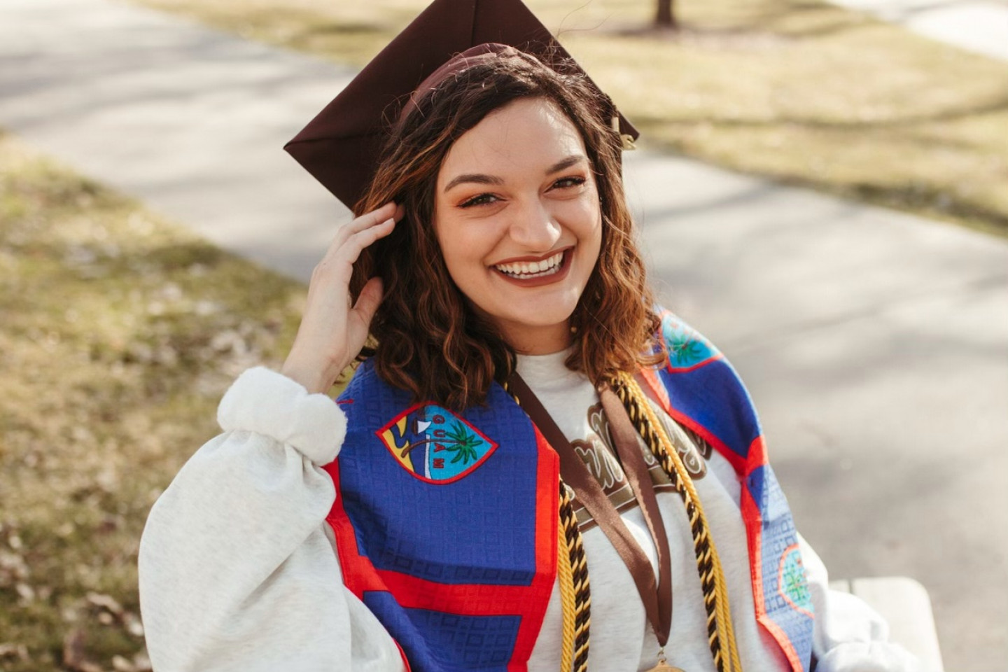 A portrait of Alyssa Zamora in her cap and gown (Courtesy: Gabby Rhodes Photography)