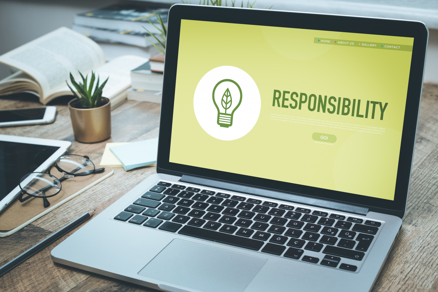 """A laptop computer with the word """"Responsibility"""" on the screen."""