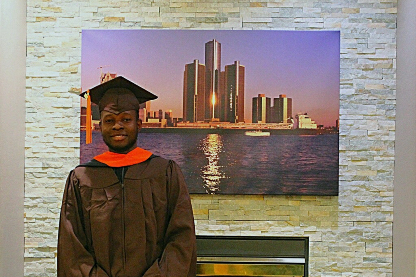 A photo of Ewaen Ediae in his cap and gown.