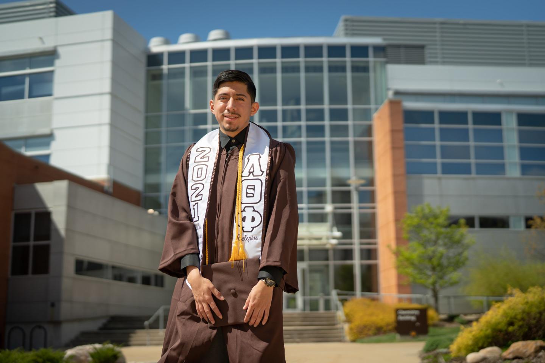 Jovanny Ruiz-Alavez poses in his graduation regalia.