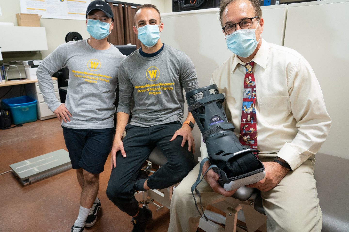 Pham Tram, Sean Clark and Dr. Daryl Lawson pose for a photo with the SenLore boot prototype.
