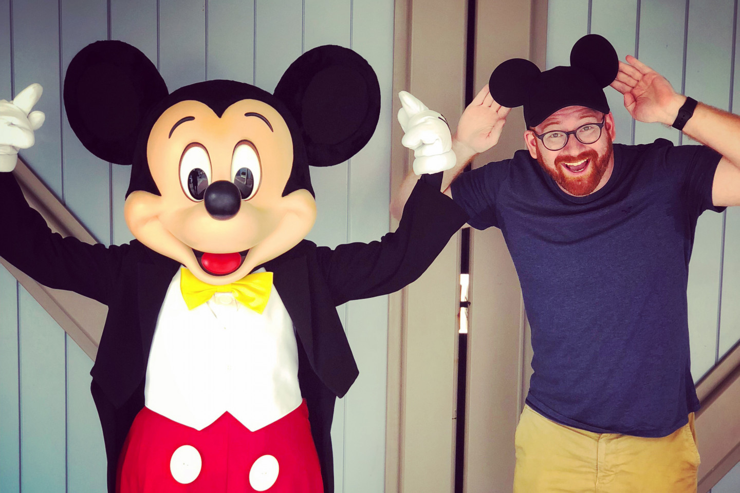 David Alpert poses for a picture with Mickey Mouse.