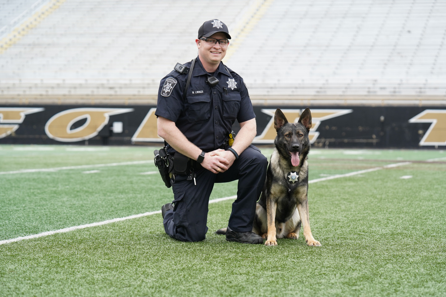 Officer Lininger and his police K9 on the field at Waldo Stadium.