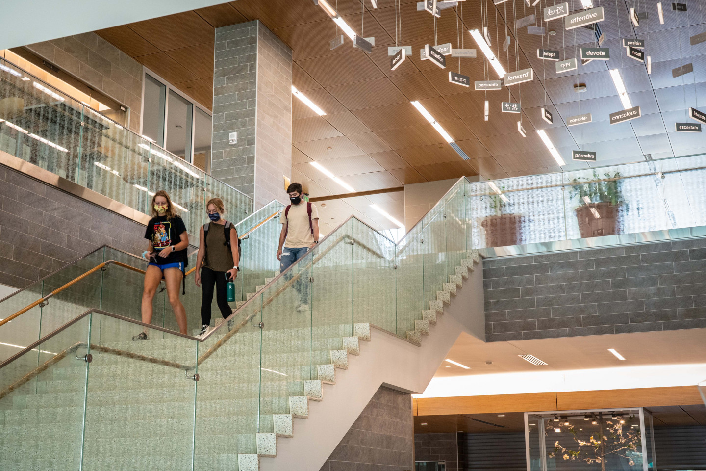 Photo of students walking down stairs.