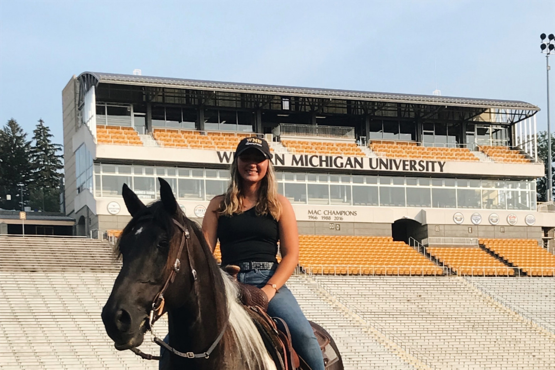 Haley Lesiow rides Triumph the horse.