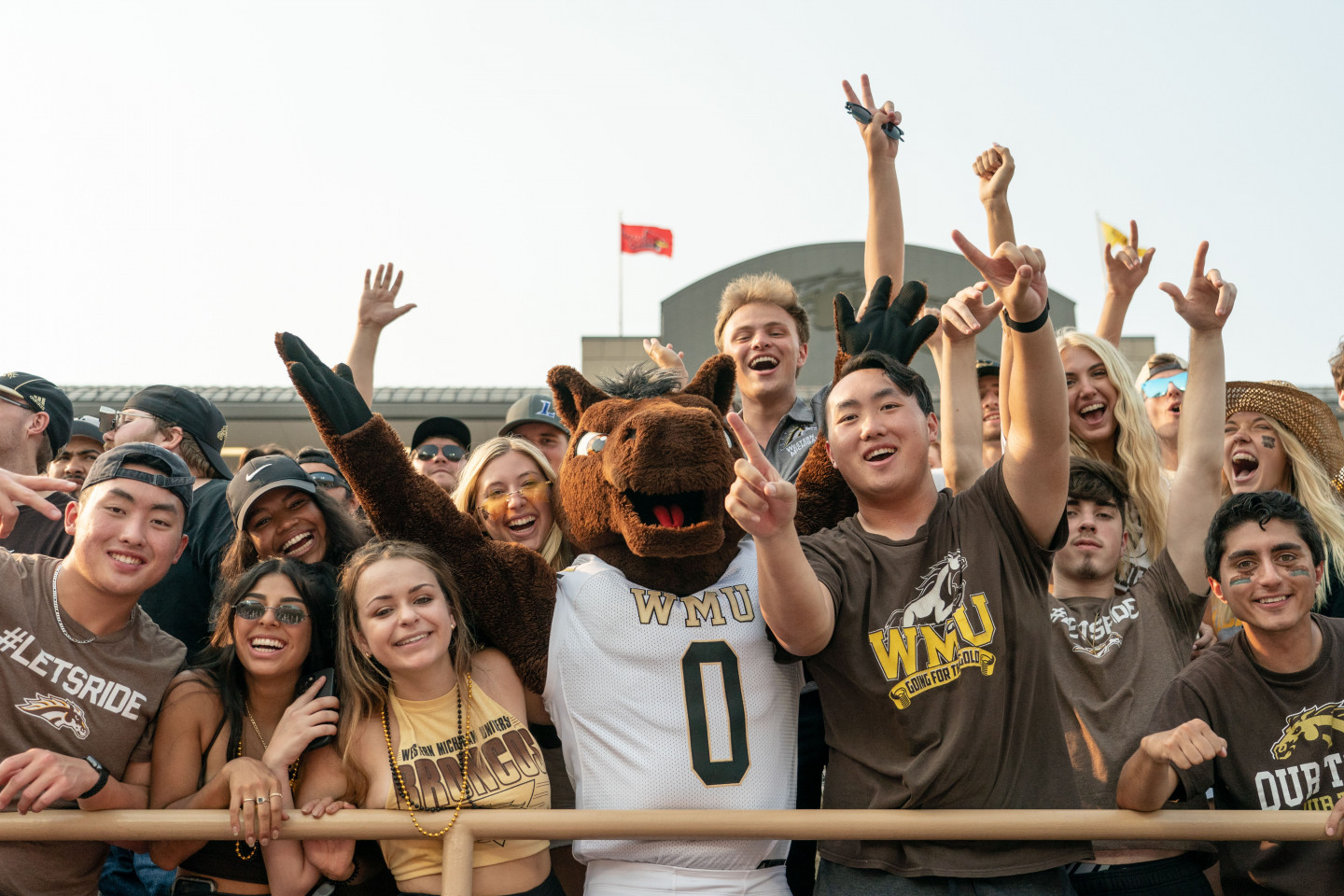 Bronco fans cheer at a WMU football game.