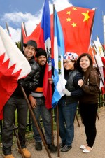 Photo of international students holding flags.