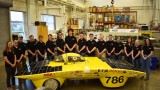 Students pose by Sunseeker racecar