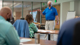 Tom Kelly instructs a lean six class in a conference room