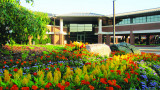 Pictured is Schneider Hall in spring with flowers in courtyard