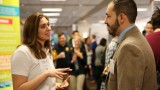 WMU student speaking with a vendor at the WMU Career Fair
