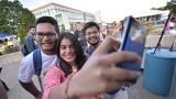 Students on Sangren Mall taking selfies