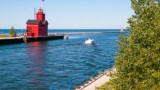 large red lighthouse on a pier