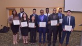 Group of finance and commercial law students holding their certificates