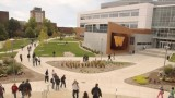 Students walking outside of Sangren Hall on campus.
