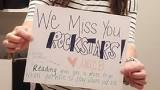 Jennifer holding sign for students
