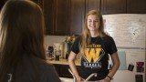 Female student in Western View apartment kitchen