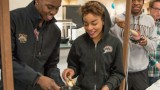 Male and female student getting food at the holiday dinner