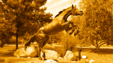 Photo of Bronco statue with a gold color overlay