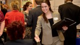 A photo of a student networking with an employer