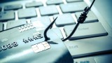 """A fish hook captures a credit card; a visual play on words surrounding the term """"phishing"""""""
