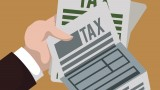 "Decorative image: cartoon of person holding ""tax"" form"