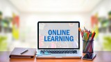 "Decorative: Laptop open on desk, reads ""Online Learning"""