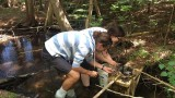 Erin McRae and Jake Lewis studying water quality of Lime Creek