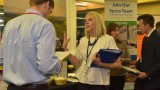 Employers and students interacting at a job fair