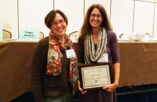 Peggy McNeal stands with Dr. Heather Petcovic receiving her award